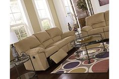 "The Kickoff Reclining Sofa from Ashley Furniture HomeStore (AFHS.com). The soft comfortable fabric of the ""Kickoff-Mocha"" upholstery collection beautifully surrounds the supportive divided back cushioning along with plush padded arms creating a relaxed contemporary design that is sure to be the perfect addition to any living room décor."