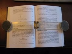 Book Holder - Homemade book holder constructed from transparent plastic, a hinge, petri dishes, and birdshot.