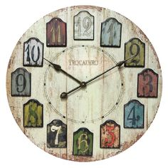 Trocadero Wall Clock...simple yet stylish. I like how the numbers look like they are on tags.