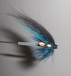 Instructions for this Tube Fly pattern can be found at: http://www.northwesttubefly.com/2012/06/black-and-blue-summer.html