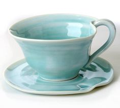 Contemporary porcelain hand thrown tea cup and saucer.Choose from the satin cream or turquoise glaze. Personlise your pieces/s with an inscription of your choice. Simply choose the inscription option at checkout and add your wording, for eg.'Mr & Mrs Lawner 11th July 2013'. (Inscripted pieces are made to order and therefore take between 2-6 weeks to be dispatched)Tea has never tasted as lovely as it does when sipped from a these gorgeous tea cup and saucers. Hand thrown on the wheel in the…