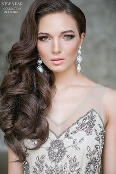 one side half up wavy wedding hairstyle for long hair