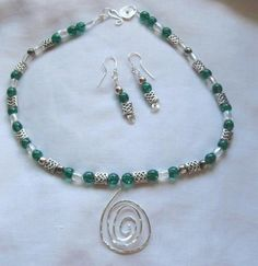 Green Celtic necklace and earring set with silver pendant. $65.00