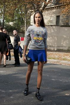 Kenzo sweater, cobalt blue skirt, and printed socks and loafers are a breath of fresh air.