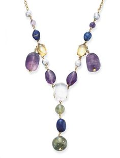 MULTI-GEM AND GOLD NECKLACE   Designed as a line of freshwater pearls, amethyst beads, tumbled lapis lazuli, cabochon citrine and rock crystal, suspending twin carved amethyst pendants, and a central emerald bead and tumbled lapis lazuli pendant, mounted in gold $6,931.00