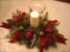 Aprende cómo hacer centros de mesa navideños con velas