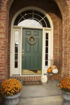 fall front porch - green front door with the brick--like the door color Green Front Doors, Exterior Front Doors, Exterior House Colors, Exterior Paint, Front Door Paint Colors, Painted Front Doors, Orange Brick Houses, Red Bricks, Green Shutters