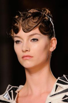 Care to experiment with futuristic hair style?  Check out finger waves in the future.