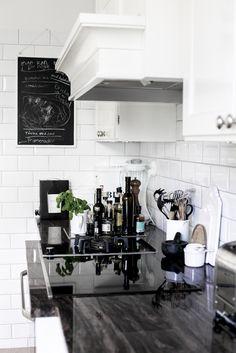 Classic kitchen. White subway tile. Black bench.