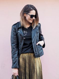 black biker jacket with embroidered jumper and gold plated midi skirt, dressed up daytime outfit