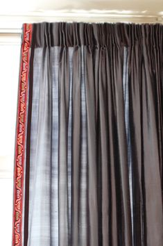 Pinch pleating details is usually a sign of custom or more expensive draperies. A simple way to get these drapes for less is to purchase standard, lined drapery panels from a store and then add the pleated detail yourself.