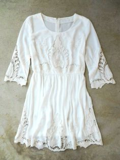 Elegant Embroidery white Dress. So cute, except for it looks a little more like a long shirt than a dress.
