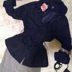 Rain coat Has stand up ruffly collar!!  Way cute with 3 buttons an ty-belt!!!!!   Nice n thin; Lt weight, and goes with silk OR jeans!! Luii Jackets & Coats