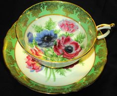 Paragon poppy anemone green gold gilt center tea cup and saucer
