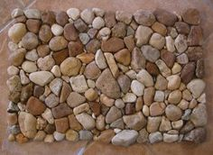 This river rock door mat is a wonderfully modern way to scrap the mud, snow or sand off your boots without having to have one of those silly. Pebble Bath Mat, Pebble Art, Easy Diy Projects, Craft Tutorials, Wood Projects, River Rock Floor, River Rocks, Rock Crafts, Diy Crafts