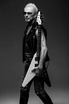 Rudolf Schenker ~ Born 31 August 1948 (age 67) in Hildesheim, (Lower Saxony), Germany. German guitarist and founding member of the hard rock band Scorpions, being the rhythm/lead guitarist and one of the main songwriters of the band. In the year 2000 Schenker was awarded the city of Hanover plaque. and the Cross of Merit First Class (Verdienstkreuz 1. Klasse) of the Lower Saxony Order of Merit.