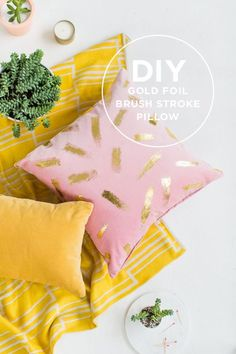 Cover a pillow with golden brush strokes.