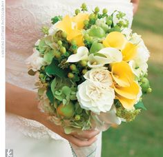 Kelli carried a bouquet of yellow mini calla lilies, ivory roses, light green hydrangea, and green poms, kumquats, and berries.---good balance of green and yellow and white