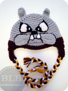 Don't mess with this dog! Handmade crochet Grey earflap beanie hat with fierce bulldog face ready for action! Maroon trim and Maroon/Gold/White braided ties. Coming from a pet-free, smoke-free home.