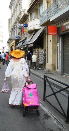 Woman on her way back from the Arles market, France
