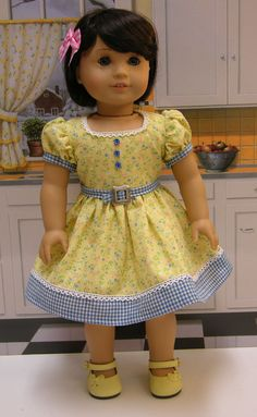 Love this dress. Have the same print in pink, never thought to pair it with gingham..... hmm.....