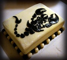 My 1st order - Skorpion cake - strawberry and vanilla cream filling. Design inspired by a scorpion tattoo picture I found on google :)  Covered in buttercream, scorpion is made of MMF.