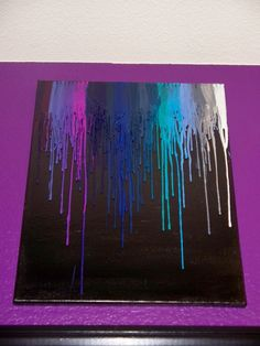 melted crayon on black canvas