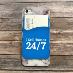 "Adhesive silicone pocket for the back of your smart phone to conveniently hold all your essentials; credit cards, business cards, lockbox key card, cash! All your wallet needs, without the wallet! Fits most smart phones! Size : 2.375""w x 3.375""h     Text reads ""I Sell Houses 24/7""™"