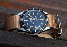 Rolex Submariner On A Marker Matching NATO watch