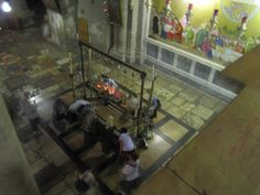 Church of the Holy Sepulcher - This is a view at the top of the steps leading up to Calvary. Here we see the Stone of Anointing (about where Jesus' body would have been prepared right after being taken off the cross. The tomb is to the right through the archway in the top left corner of this photo.