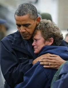 President Barack Obama hugs North Point Marina owner Donna Vanzant, as he tours damage done by Hurricane Sandy in Brigantine, N.J., on Wednesday. Putting aside partisan differences, Obama and Republican Governor Chris Christie toured storm-stricken parts of New Jersey together, taking in scenes of flooded roads and burning homes in the aftermath of Superstorm Sandy.