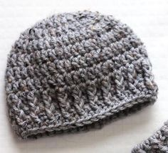 """""""This newborn hat is easy, quick and versatile, named 'The Parker' after my own son-to-be! This beanie is basic and gender neutral, great with or without additional embellishments like appliques or buttons. This is a great beginner project as it mostly uses double crochets."""""""