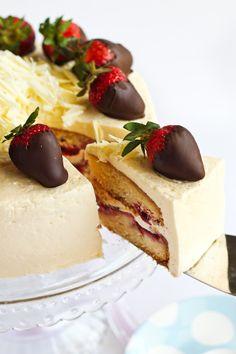 marcepan cake with chocolate covered strawberries on top