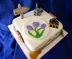 Saffron Walden cake. The crocus, town hall, church and pub signs all around the cake!