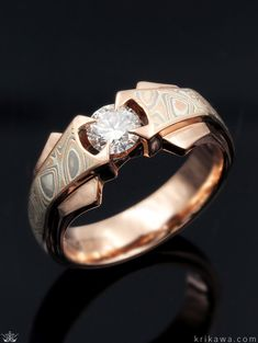 A bold angular ring with intersecting planes of mokume and platinum. Reminiscent of wings, the mokume flows from the center stone around the entire band. Pictured here in rose gold and Champagne Mokume Gane. A great men's engagement ring option! Gypsy Rings, Boho Rings, Mens Gold Rings, Men Rings, Engagement Rings For Men, Solitaire Engagement, Stylish Rings, Turquoise Rings, Gemstone Jewelry