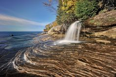Miners Beach Falls , Pictured Rocks National Lakeshore, Michigans upper peninsula This little waterfall is hidden on the far East end of Lake Superior's Miners Beach. The Pictured Rocks get their name because many of the sandstone formations and walls have been stained red, orange, black, white, and green from traces of minerals.