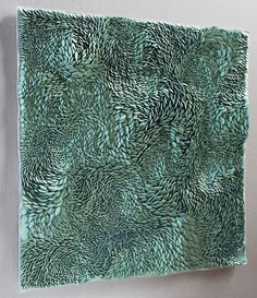 Fenella Elms - Ceramics Artist - Flows | 'Mounted for wall hanging, these works are intuitively built in porcelain clay to create shifting perspectives.  Individually made beads of clay joined to a sheet of porcelain with slip before the whole work is fired together to make one, single piece.'