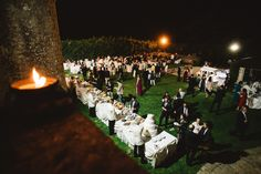 Outdoor wedding dinner in Puglia. Medieval castle for your event. Ph. Francesco Gravina Wedding planners: Michela Savino and Emanuela Formoso