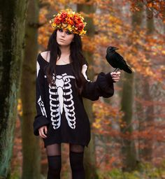 autumn goth, skeletal, black cut out dress, thigh high socks + black tights, flower crown. great october/halloween outfit.