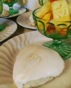 Homemade lemon poppy seed scones with lemon butter icing.