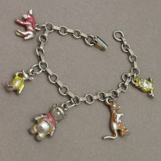 I had this bracelet.  It was a gift from my birthday party.  I loved it and still love charm bracelets.