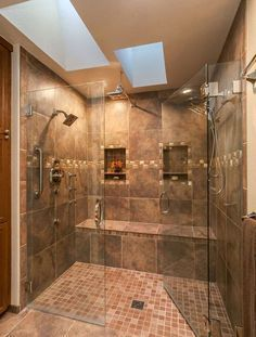 Explore this luxurious expensive spa like Master Bathroom Retreat with its HUGE double headed shower, tile bench, custom tile features and clear glass door