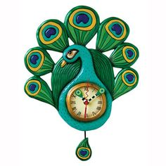 This whimsical teal and green pendulum clock is called `Pretty Peacock`, and is by Allen Designs. Made of cold cast resin, the clock features a brightly colored teal peacock, with spread out green an Peacock Decor, Peacock Art, Peacock Room, Peacock Colors, Peacock Theme, Peacock Feathers, Eclectic Clocks, Clock Art, Wall Clocks