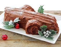 Buche de Noel (Yule Log) with an incredibly delicious, light as air flourless chocolate cake. Christmas Yule Log, Christmas Desserts, Holiday Treats, Christmas Log Cake, Christmas Recipes, Christmas Foods, Christmas Ideas, French Christmas, Kid Desserts