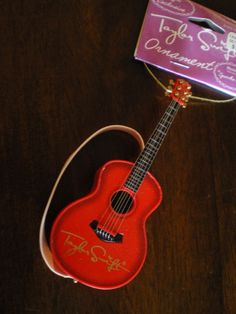 Will someone please get me this....TAYLOR SWIFT Red GUITAR ORNAMENT Plays SPARKS FLY Song MUSICAL NEW Country NWT