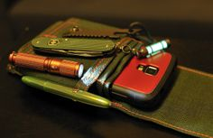 Skinth; Milky Way Fisher Bullet Space Pen Lime Green Olight i3S Ember Orange, Special Edition. Victorinox Alox Cadet in OD Green Titanium G...