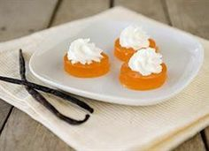 A jello shot version of a creamsicle.  Orange gelatin with vanilla flavored vodka.  A dollop of whipped cream top of this delicious jello shot.  12 servings
