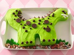 Dinosaur birthday cake.  The spikes are hershey kisses - great idea!
