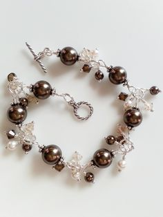 This bracelet is made with sterling silver and Swarovski faux pearls in white and brown and matching Swarovski crystals. It is perfect as a bracelet for a bride or a bridesmaid bracelet. Keep in mind