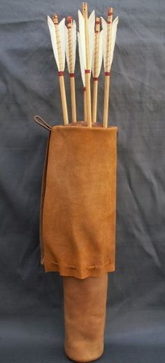 This quiver is really nice. The flap folds up and ties at the top to cover the arrows. While this one is for standard arrows a LARP version would probably be fairly simple to make. - Medieval and Tudor Quivers